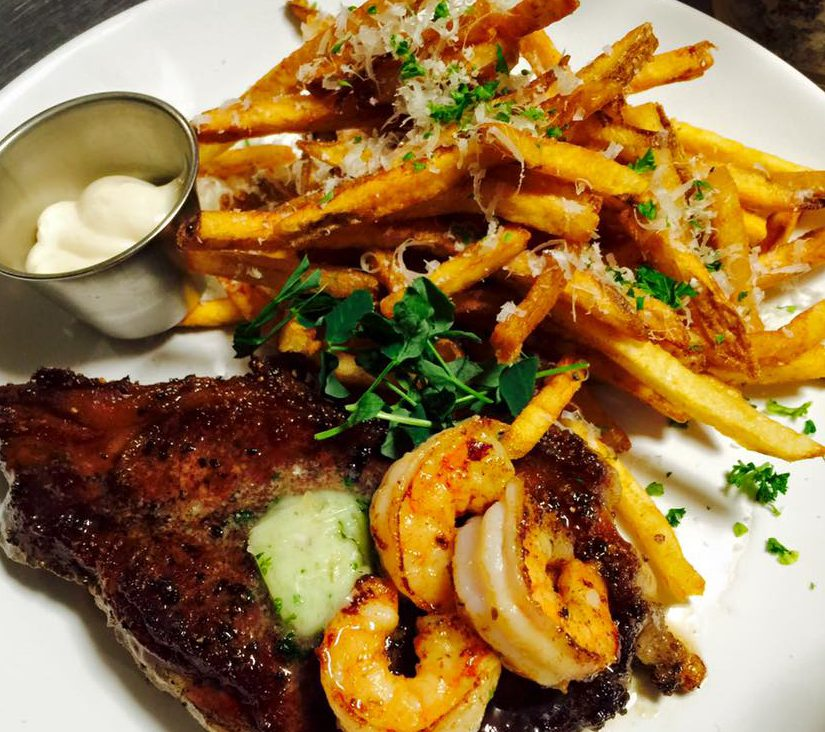 Steak, shrimp, and fries at The Wrigley Taproom & Eatery